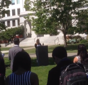 Sara Lone speaking on the steps of California's Capital Hill
